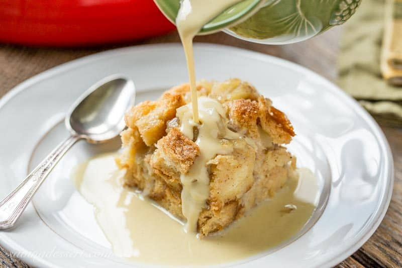 Apple Bread Pudding with Apple Brandy Sauce - a wonderfully comforting dessert with a spongy, custardy middle, layers of soft brandy spiked apples and a crispy top.  Don't forget the drizzle with Apple Brandy Sauce - total apple heaven! savingdessert.com #breadpudding #applebreadpudding #pudding #apple #dessert #savingroomfordessert