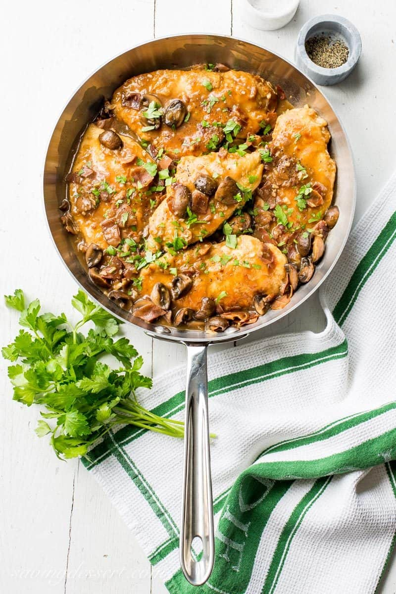 Classic Chicken Marsala ~ tender chicken breasts are seasoned and sautéed, then simmered in a Marsala wine sauce with shallots, prosciutto, and plenty of earthy mushrooms.  Your guests never have to know how easy this is to make! savingdessert.com #chickenmarsala #chickendish #chicken #chickenmushrooms #marsala