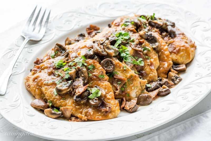 A platter of classic Chicken Masala with mushrooms