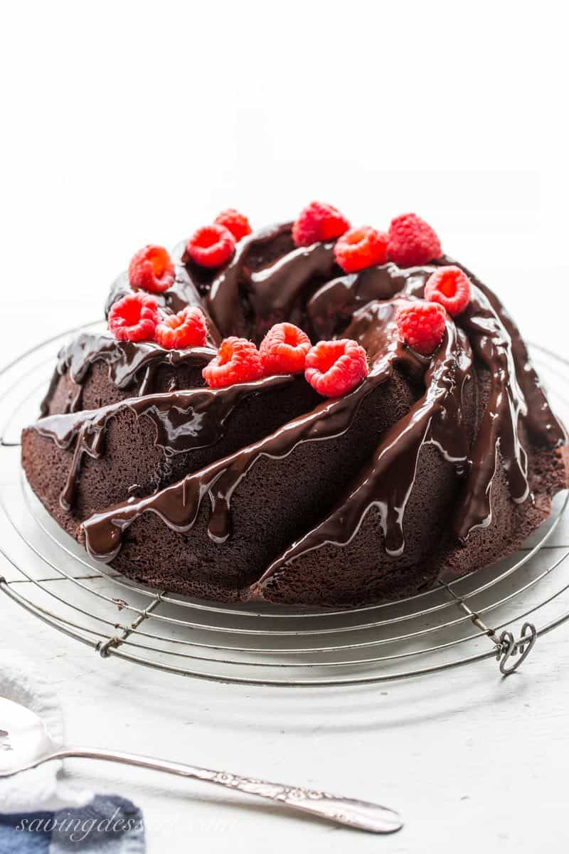 Chocolate Bundt Cake ~ a rich, moist, not too sweet cake with plenty of chocolate flavor and a little tang from the buttermilk. Drizzle with a simple glaze, or a dusting of powdered sugar for an easy, make-ahead cake sure to please your favorite chocolate lover! savingdessert.com #chocolate #chocolatecake #dessert #bundtcake #savingroomfordessert