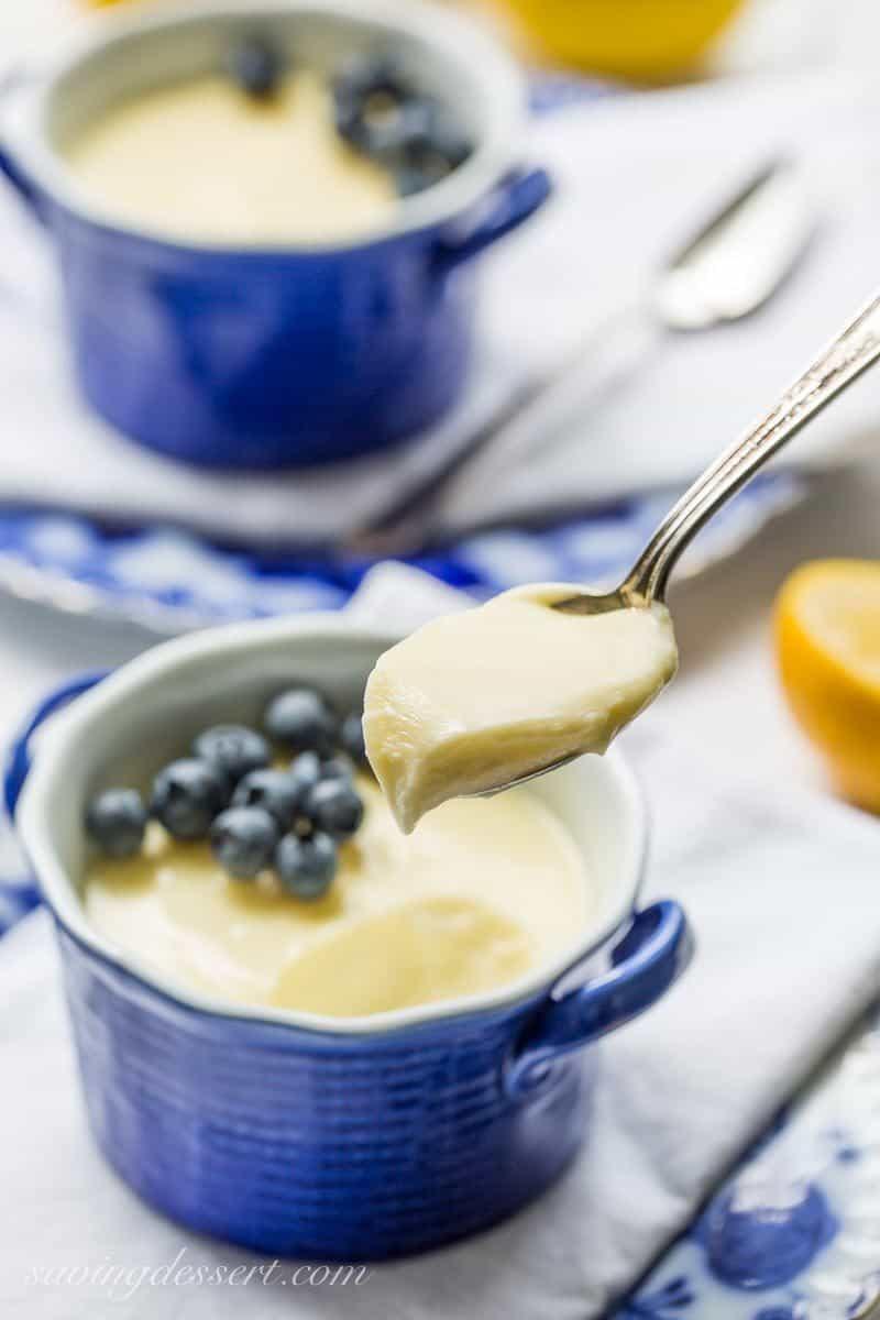 Lemon Posset - a cross between a lush pudding and a silky lemon curd, this amazing English specialty is made with just three simple ingredients. savingdessert.com #lemon #pudding #posset #dessert #savingroomfordessert