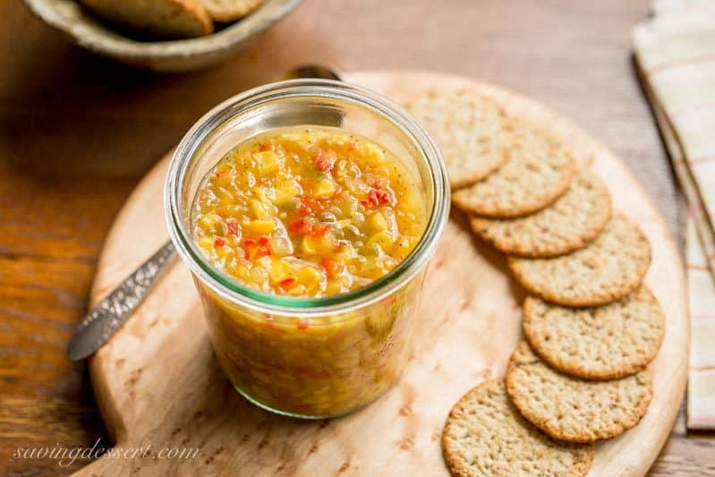 Spicy Corn Relish - a sweet and spicy corn relish terrific served on hot dogs, hamburgers, nachos, sandwiches or even a cracker. This relish is also the perfect tangy topping for grilled meats and fish too! www.savingdessert.com