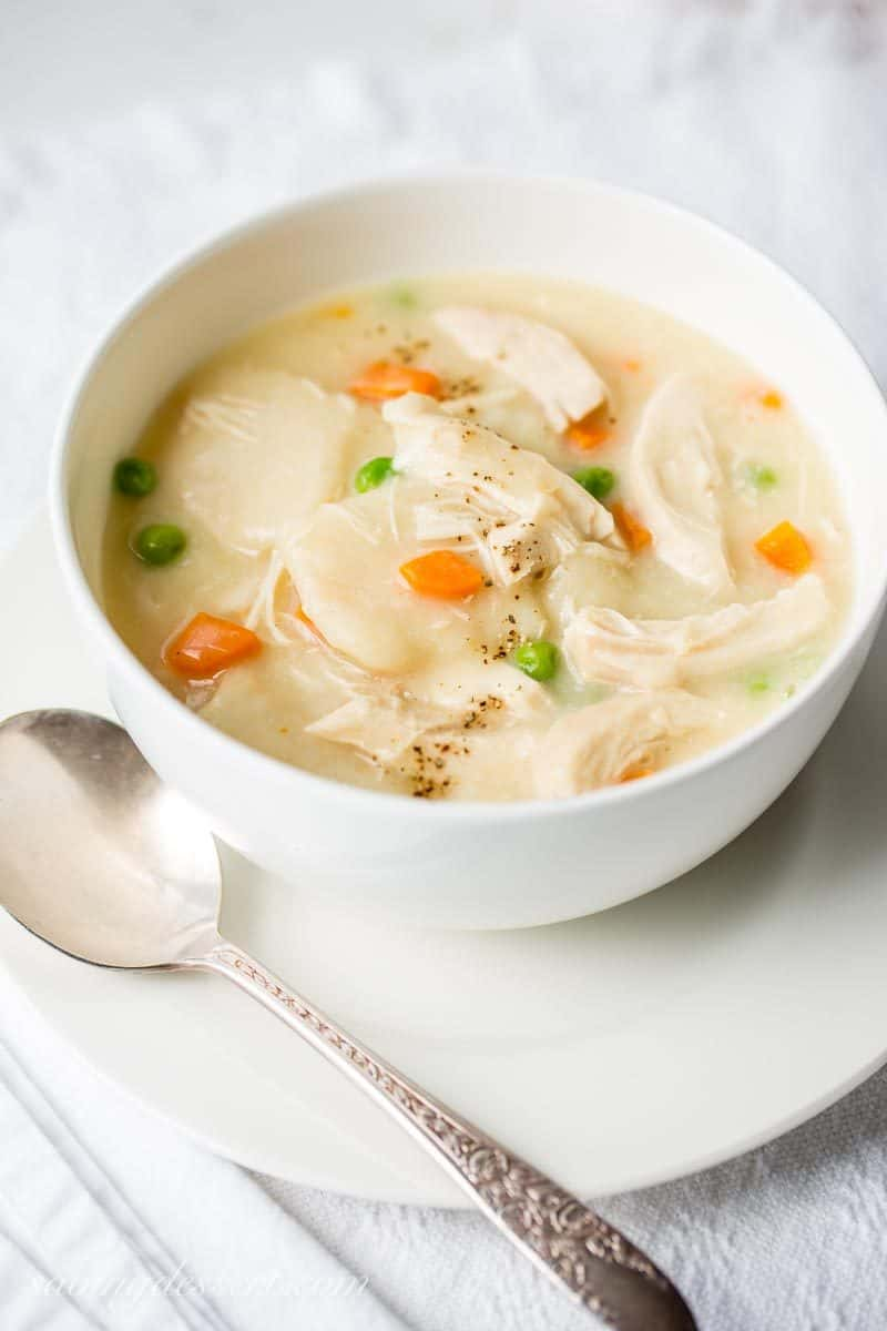 Homemade Chicken and Dumplings ~ a deliciously rich homemade chicken stock is used for the base of this warming, healing pot of pure southern comfort food. www.savingdessert.com #savingroomfordessert #chickenbroth #chickenstock #chickenanddumplings #dumplings #dinner #chicken