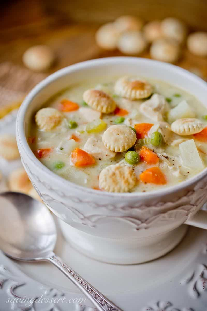 Hearty Chicken Pot Pie Soup ~ a creamy chicken soup with potatoes, peas, onion, celery and carrots. All the flavors of a homey chicken pot pie without the crust! www.savingdessert.com #chickenpotpie #chickensoup #soup #comfortfood