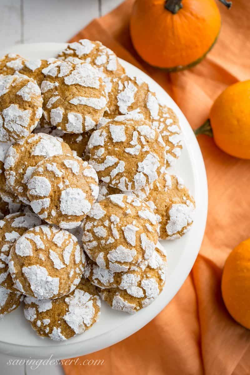 Pumpkin Crinkle Cookies ~ soft and sweet, with plenty of pumpkin flavor and pumpkin pie spice, these easy to make cookies are the perfect fall bite! www.savingdessert.com #savingroomfordessert #pumpkin #pumpkincrinklecookies #crinklecookies #cookies #dessert