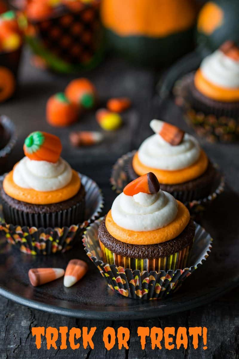 Easy Chocolate Cupcakes Recipe with Fluffy Vanilla Buttercream Frosting ~ classic chocolate cupcakes that are tender and moist, and don't fall apart when you take a big bite. Topped with fluffy, melt in your mouth buttercream frosting with just a little bit of cream cheese added for stability and creaminess. Not just for Halloween! savingdessert.com #savingroomfordessert #cupcakes #halloween #chocolatecupcakes #chocolatecake #cake #mayonnaisecake #dessert