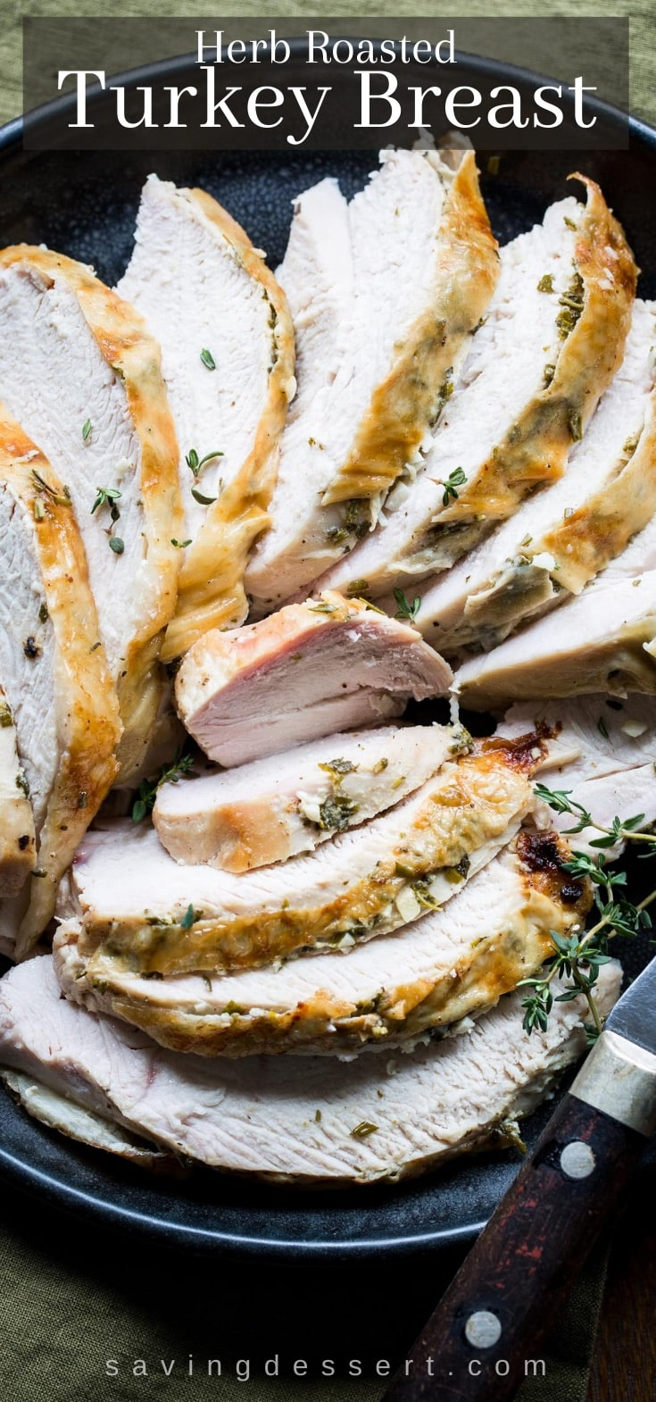 A platter of sliced turkey breast with fresh herbs