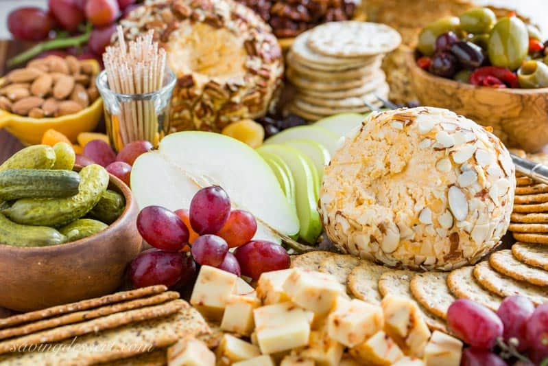 Mom's Party Cheeseball ~ every party needs an easy and delicious cheese ball made with cream cheese, mild and sharp cheddar cheese and a few spices. A make ahead appetizer that holds up wonderfully for hours and is great served with crackers, bread, fruit and nuts. www.savingdessert.com #cheeseball #appetizer #savingroomfordessert #partyappetizer