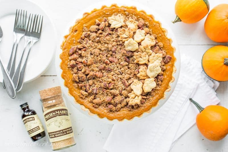 Pumpkin Tart with Pecan Crumble ~ a surprisingly unique and delicious tart with a cream cheese pumpkin base and a sweet, crunchy crumble top loaded with toasted pecans. www.savingdessert.com #pumpkin #pumpkintart #pumpkinpie #Thanksgivingdessert #thanksgiving