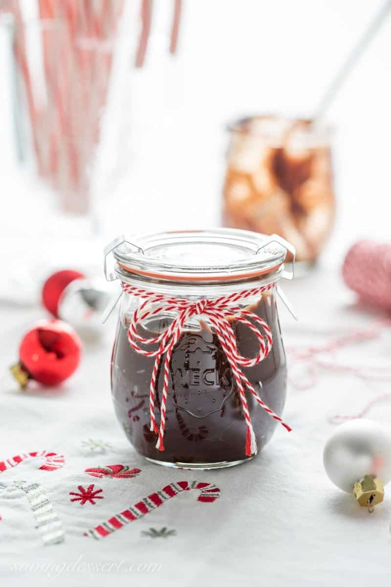 Chocolate Peppermint Sauce ~ a silky smooth, rich all-purpose chocolate sauce with bright peppermint flavor that may be the highlight of your holiday dessert table. Easy to make and perfect served on ice cream, stirred in warm milk for a fantastic hot chocolate, drizzled on cookies or cake or as a dip for fruit. Perfect for gifting too! www.savingdessert.com #savingroomfordessert #chocolate #chocolatesauce #peppermint #dessert