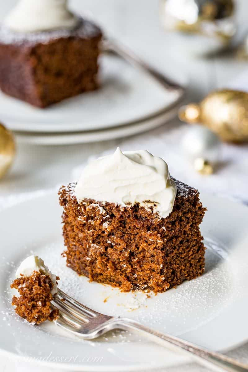Old-Fashioned Gingerbread Cake with Lemon Cream - if you love ginger and molasses, and a cake that's not too sweet, this simple one-bowl Gingerbread is for you (and me!) www.savingdessert.com #savingroomfordessert #gingerbreadcake #gingerbread #Christmasbaking #holidaybaking