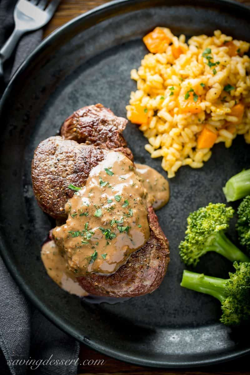 Thick and juicy Beef Tenderloin Steak with Herb Pan Sauce served with broccoli and rice