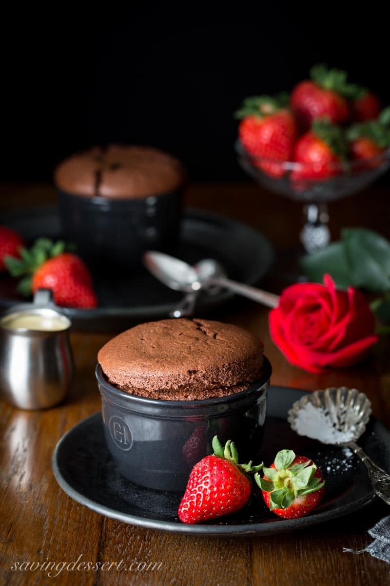 individual chocolate souffle with strawberries and a creme anglaise