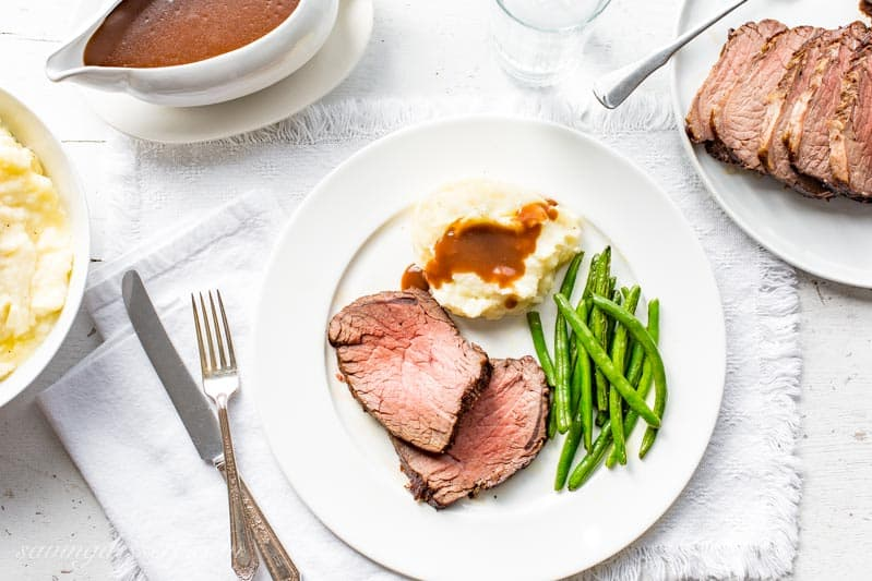 Classic Roast Beef and Gravy with mashed potatoes and green beans. www.savingdessert.com