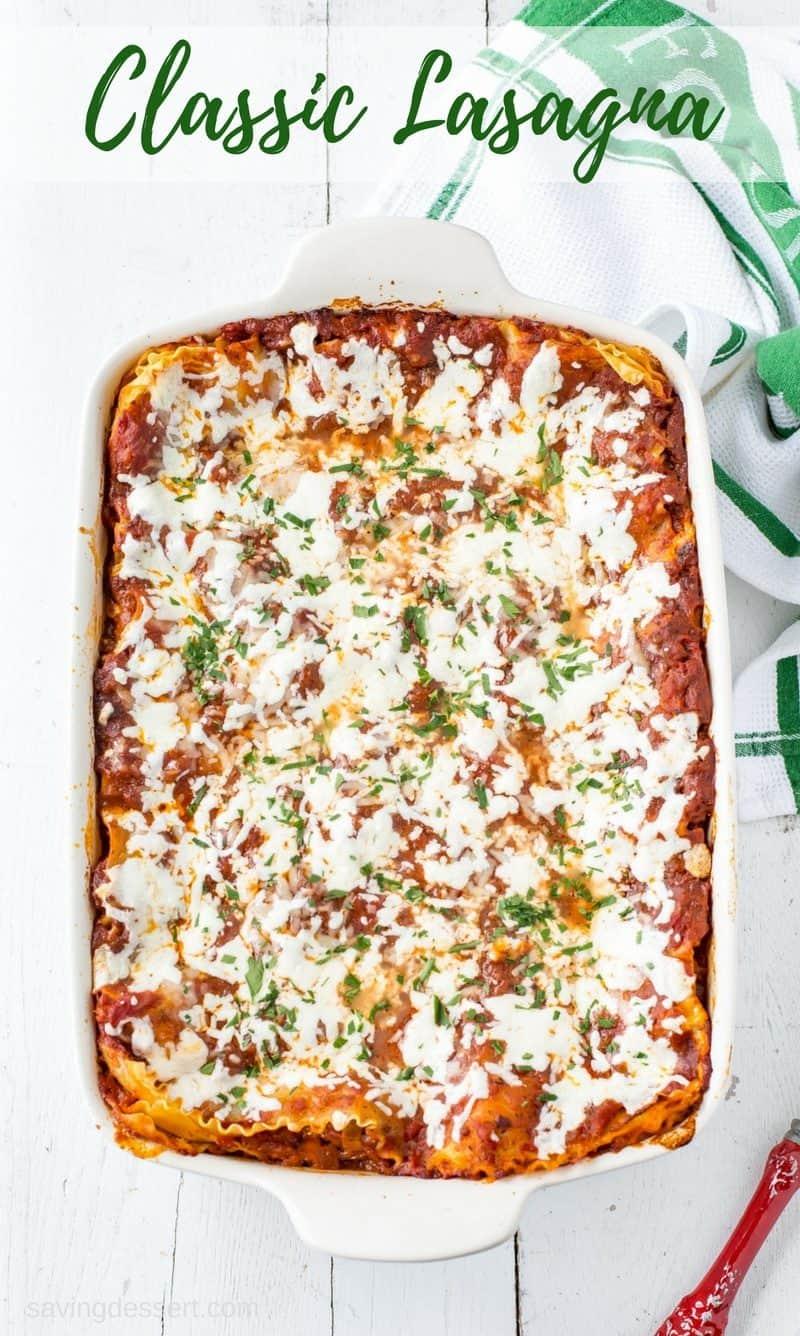 A big pan of classic rich, meaty & cheesy lasagna from Savingdessert.com
