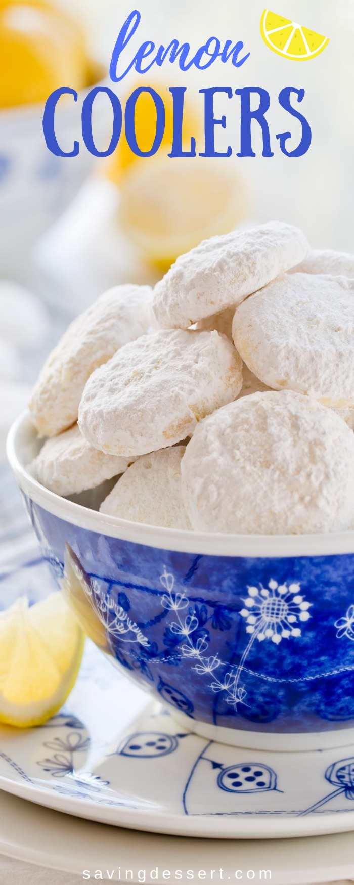 Lemon Coolers -hot from the oven, these melt-in-your mouth cookies are tossed in a mixture of crystallized lemon and powdered sugar for the most incredible intense lemon flavor ever! #lemon #lemoncookies #lemoncoolers #cookies #baking