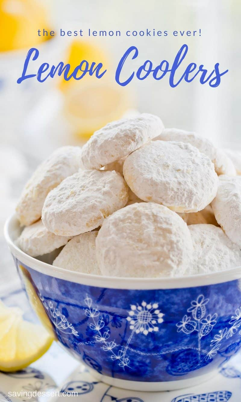 A bowl of Lemon cooler cookies covered in powdered sugar