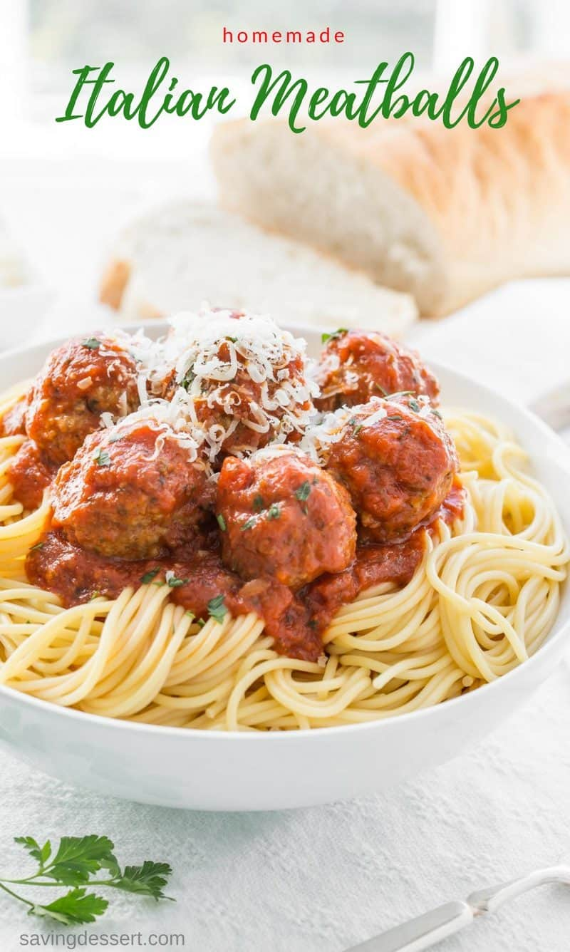 Bowl of spaghetti with meatballs and shredded Parmesan Cheese
