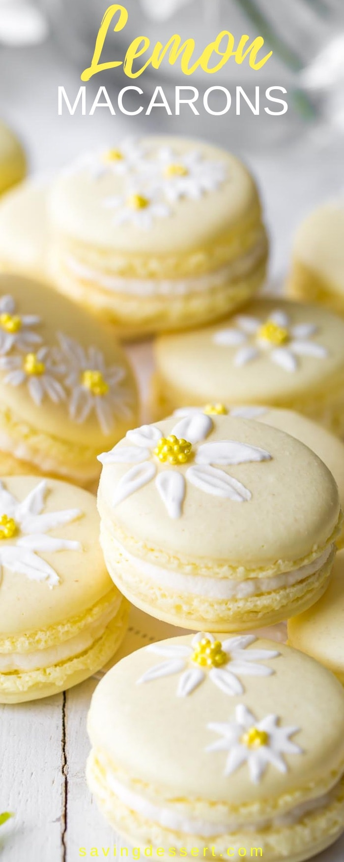 Lemon Macarons - brighten your day with these delicious cookies decorated with a few brushstrokes of royal icing and sprinkles to help usher in the first warm days of spring. #savingroomfordessert #macarons #lemon #cookies #meringuecookies #lemonmacarons #Italianmacarons #decoratedmacaron #macaron