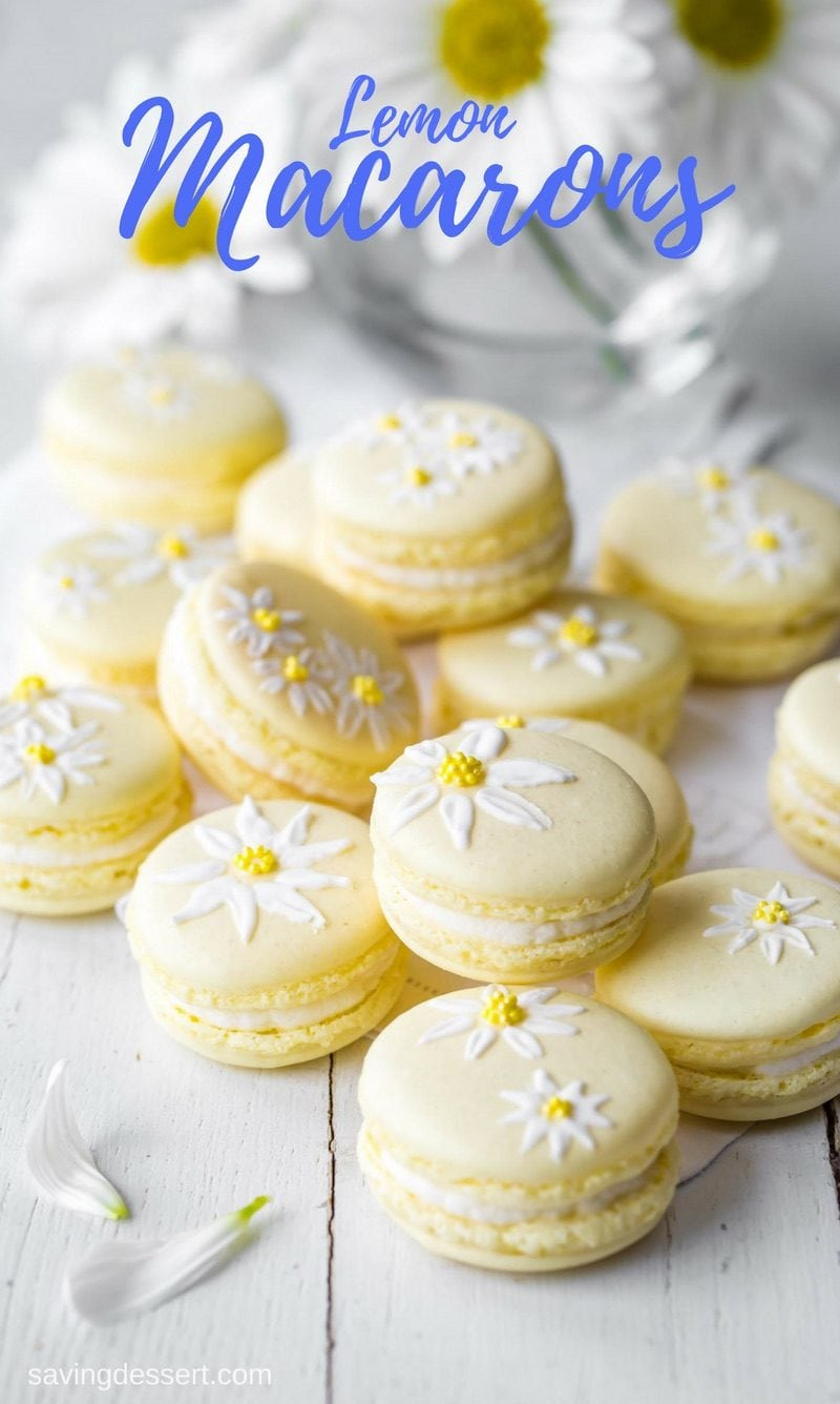 Brighten your day with these delicious Lemon Macarons decorated with a few brushstrokes of royal icing and sprinkles to help usher in the first warm days of spring. www.savingdessert.com #savingroomfordessert #macarons #lemon #cookies #meringuecookies #lemonmacarons #Italianmacarons