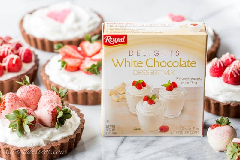 Royal Delights White Chocolate Dessert Mix box with Chocolate Tarts topped with sprinkle hearts, strawberries and raspberries