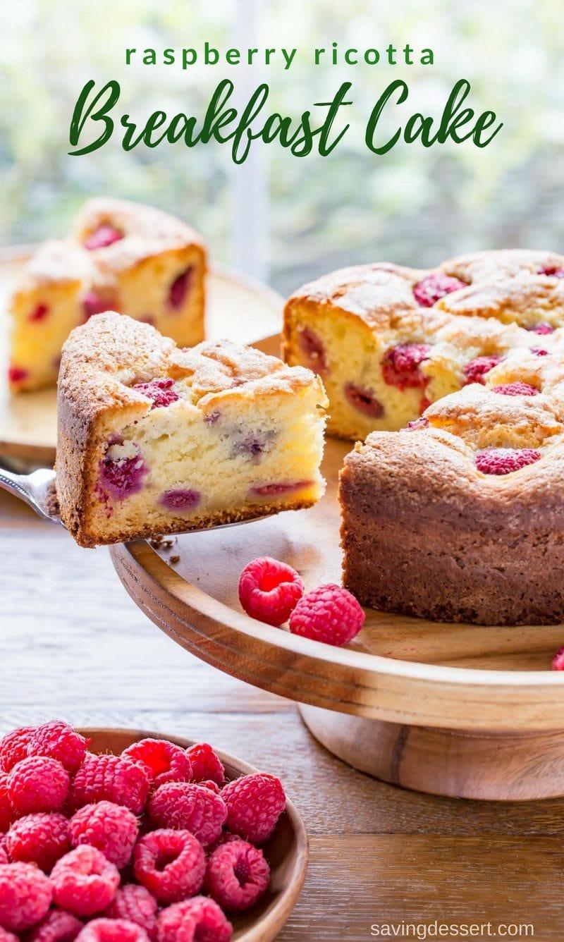 Sliced raspberry ricotta breakfast cake with fresh raspberries