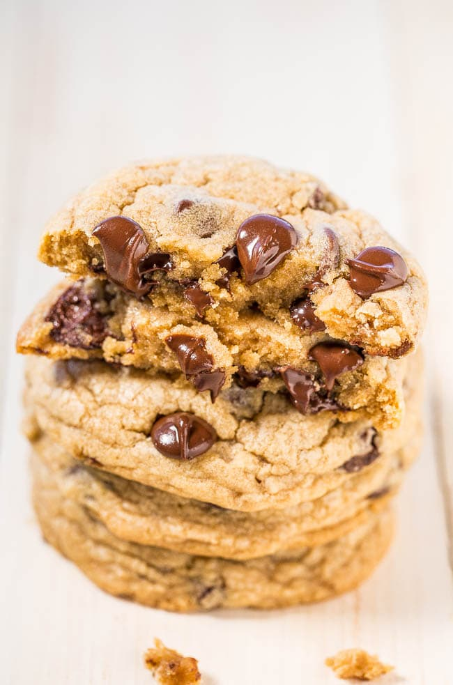 a stack of chocolate chip cookies with melted morsels on top