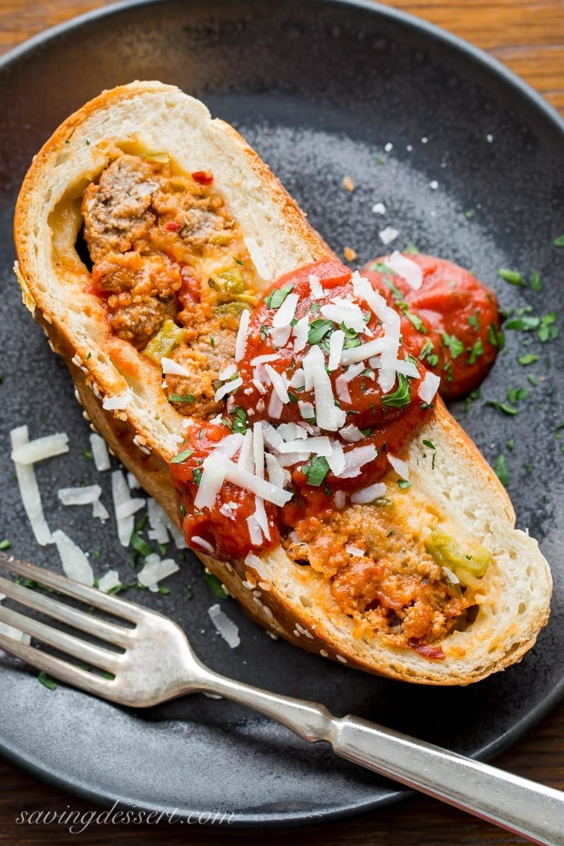 Sliced cheesy meatball stromboli with pizza sauce