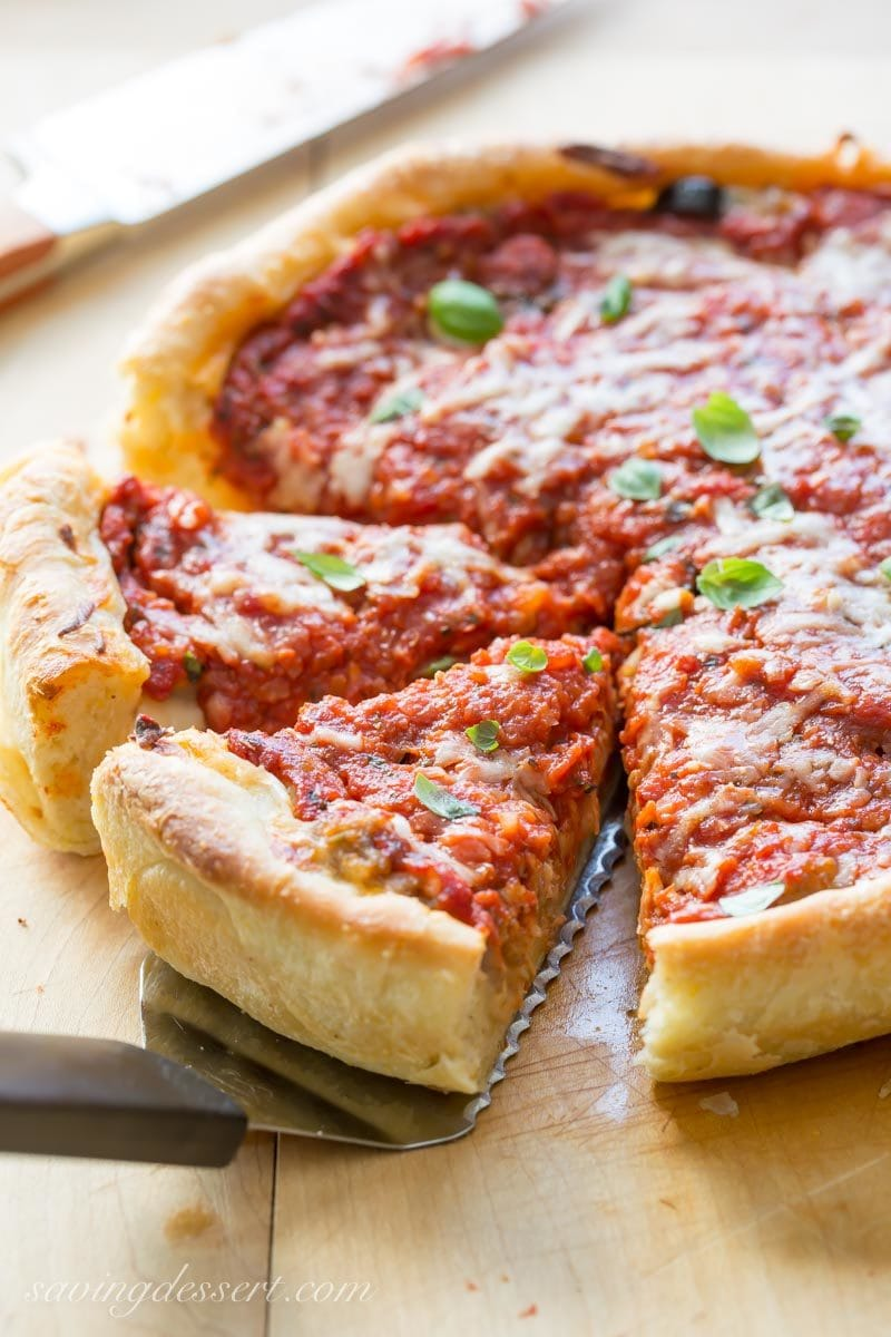 sliced Chicago-style deep-dish pizza on a cutting board