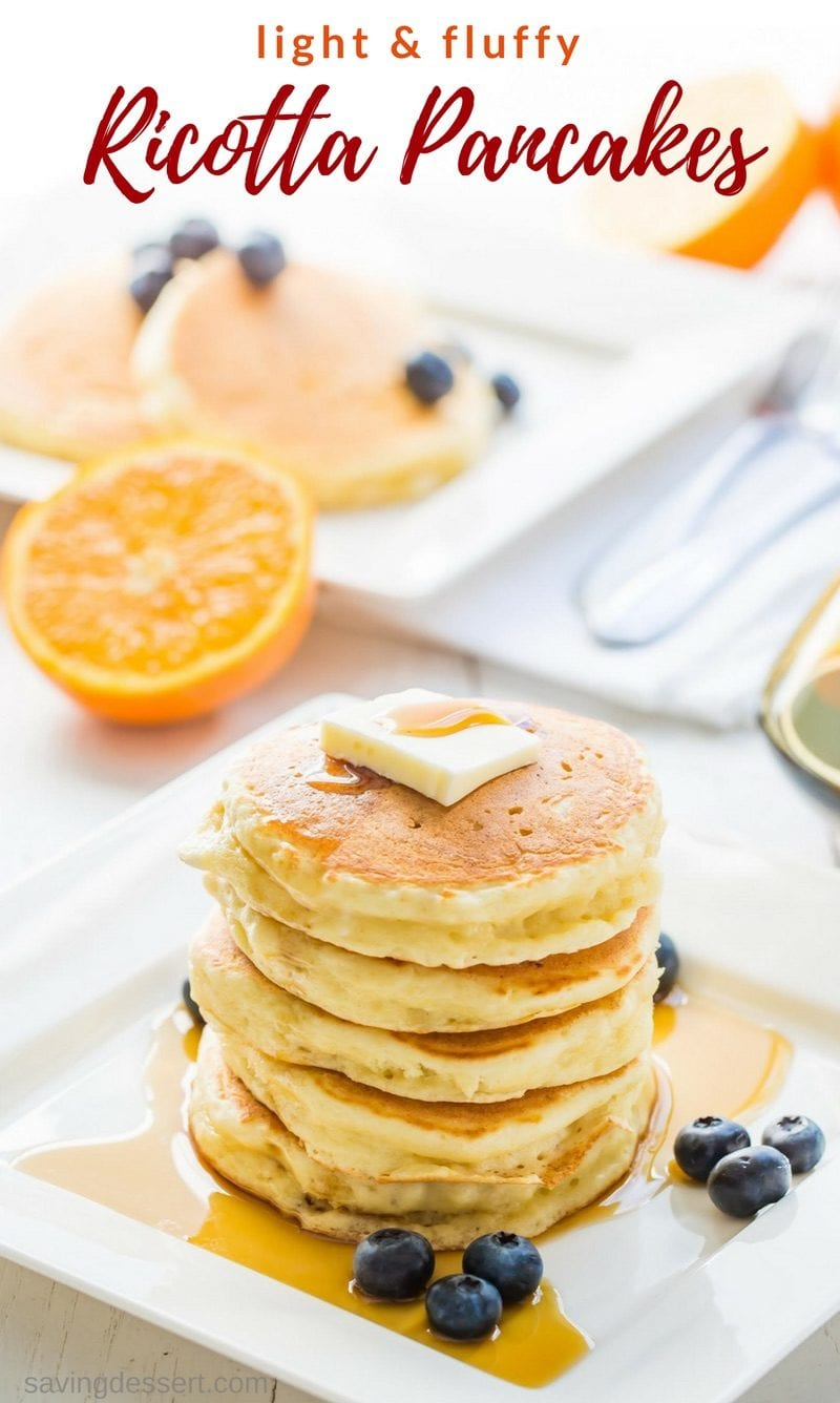 Light & fluffy Ricotta Pancakes with hints of lemon and a fantastic texture to soak up a little syrup. Serve with your favorite fresh fruit for a delightful and delicious way to start the day! www.savingdessert.com #savingroomfordessert #pancakes #ricotta #ricottapancakes #easypancakes #breakfast #brunch #mothersday #weekend