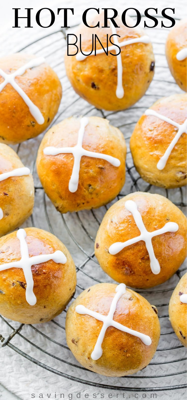 Hot Cross Buns - lightly sweet, orange scented yeast rolls with currants, raisins and plenty of warm spices. #hotcrossbuns #sweetbuns #buns #hotcross #easter #brunch #raisinrolls #holidaybaking