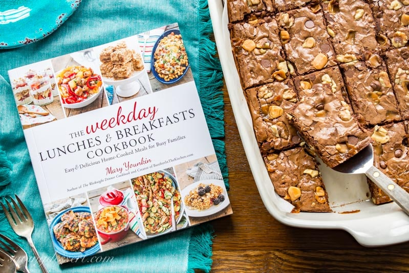 The Weekday Lunches & Breakfasts Cookbook and a pan a brownies
