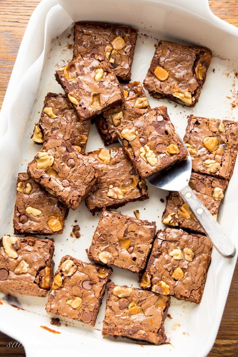 A pan of chocolate brownies with walnuts, chocolate chips and caramel