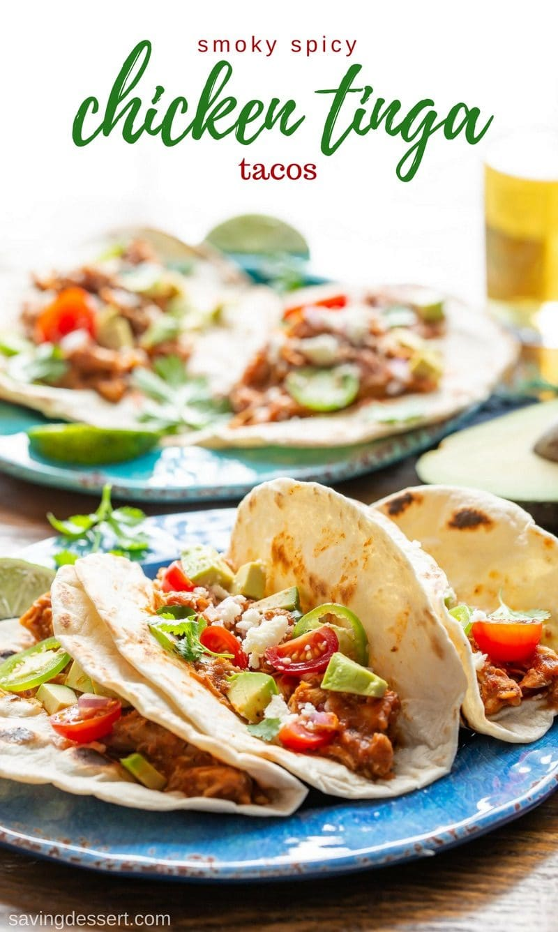 Smoky Chicken Tinga Tacos (tinga de pollo) - a flavorful Mexican dish made with fire roasted tomatoes, chipotle chilis in adobo sauce, and tender, shredded chicken. Serve as a topping for tostadas with a layer of refried beans, or as a filling for tacos, this delicious smoky chicken won't get lost under layers and layers of toppings! #savingroomfordessert #chickentacos #tacotuesday #tinga #chickentinga #cincodemayo #mexican #adobosauce #chipotle