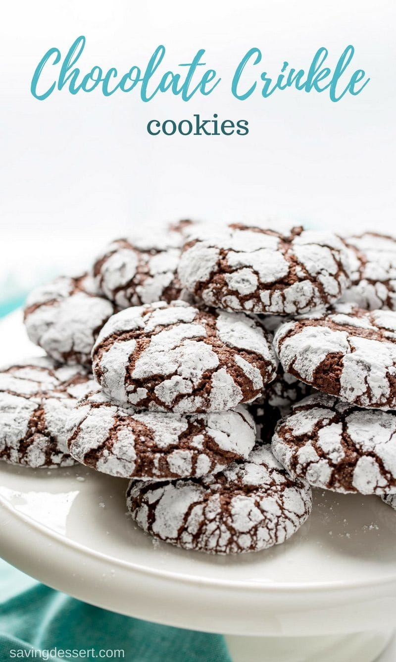 Chocolate Crinkle Cookies are puffy and soft, with a deep, rich chocolaty flavor, and they're so darn pretty too! These are no less than chocolate cookie perfection and great served any time of the year. #savingroomfordessert #chocolatecookie #crinklecookies #crinkle #cookie #chocolatecrinklecookie #chocolatedessert