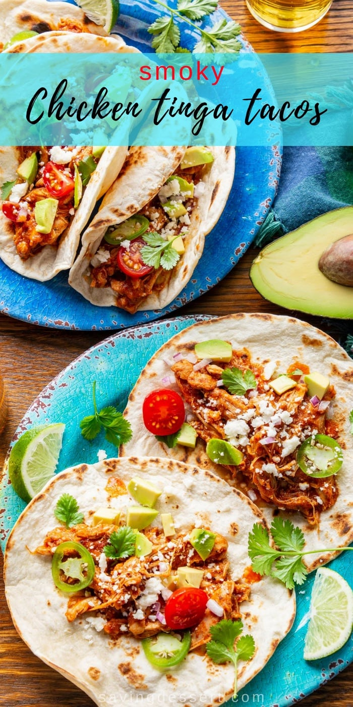Smoky Chicken Tinga Tacos (tinga de pollo) - a flavorful Mexican dish made with fire roasted tomatoes, chipotle chilis in adobo sauce, and tender, shredded chicken. Serve as a topping for tostadas with a layer of refried beans, or as a filling for tacos, this delicious smoky chicken won't get lost under layers and layers of toppings! #savingroomfordessert #chickentacos #tacotuesday #tinga #chickentinga #cincodemayo #mexican #adobosauce #chipotle #taco