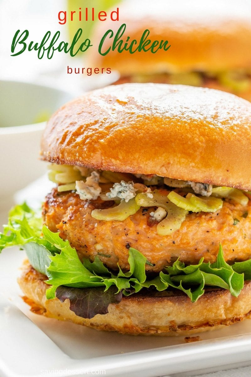 Tasty Grilled Buffalo Chicken Burger Recipe - all the flavors that you about a great Buffalo flavored chicken recipe in one easy burger! Try this spicy, juicy chicken burger with a classic celery stick topper and crumbled blue cheese. #savingroomfordessert #chickenburger #baffalochickenburger #buffalo #grilledburger #grilledchicken #grilledbuffalo #burger
