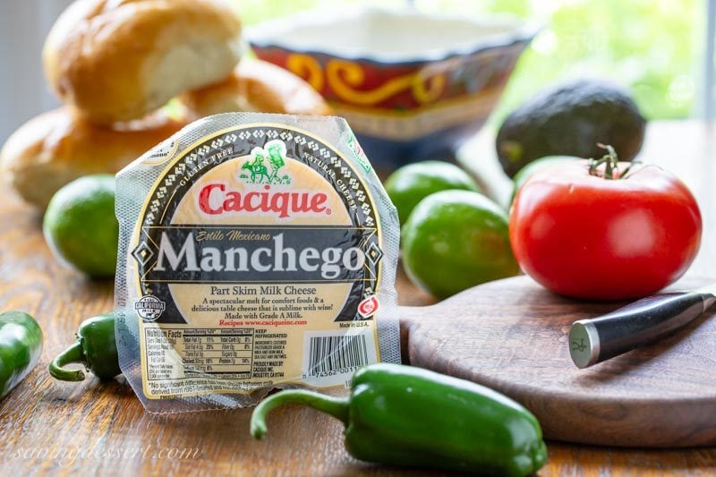 Manchego cheese, tomatoes, rolls, limes and jalapeños