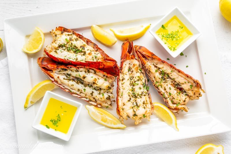 grilled lobster tails with lemon wedges and melted butter