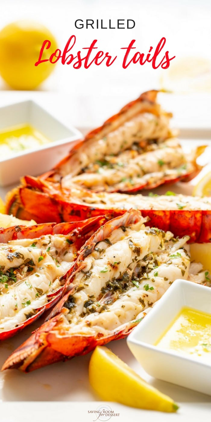 Grilled Lobster Tails on a platter with melted butter and lemon wedges