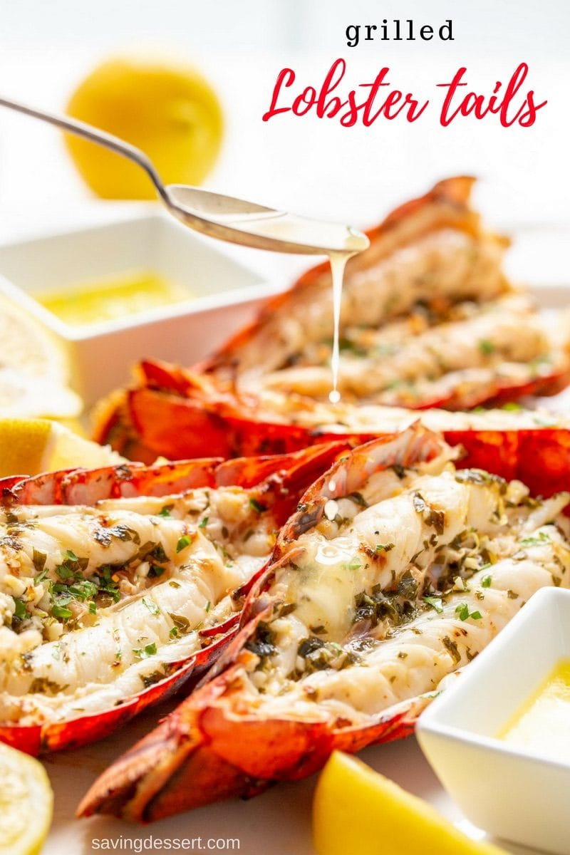Grilled Lobster Tails with drizzled butter served with lemon wedges