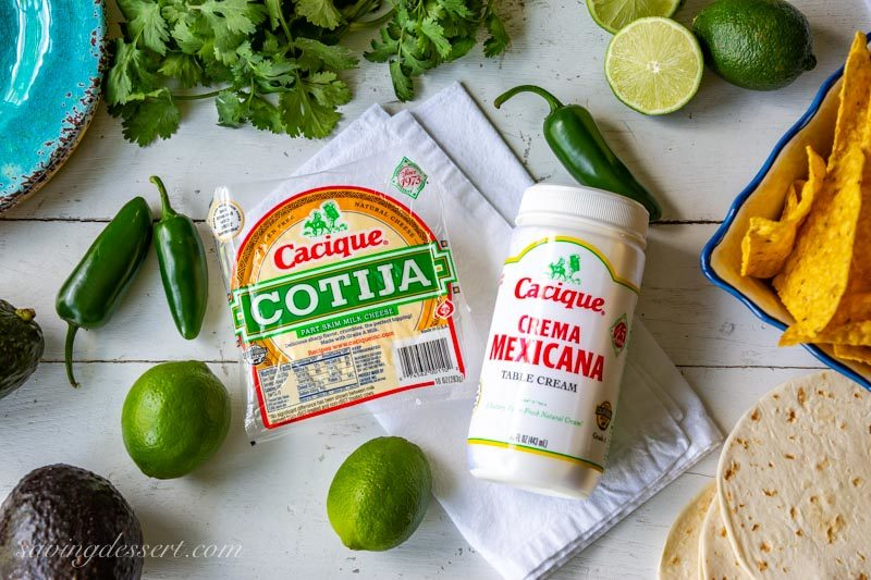 Cotija cheese, limes, cilantro, chips, tortillas and Crema Mexicana