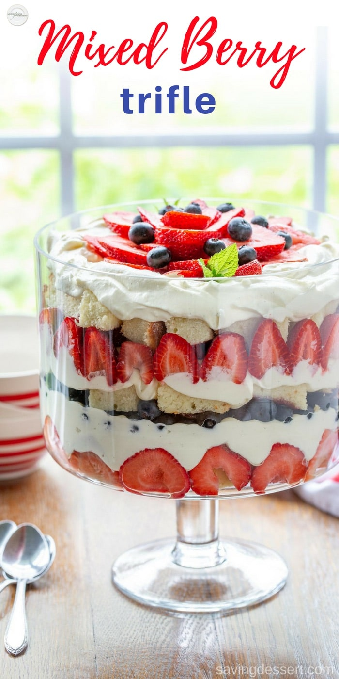 Our Mixed Berry Trifle is made with layers of fresh berries, chunks of sweet pound cake smeared with a little strawberry jam and a luscious vanilla cream custard. This lovely dessert is great for any occasion, it's easy to make and it serves a crowd! #savingroomfordessert #patriotic #dessert #trifle #berries #strawberry #blueberry