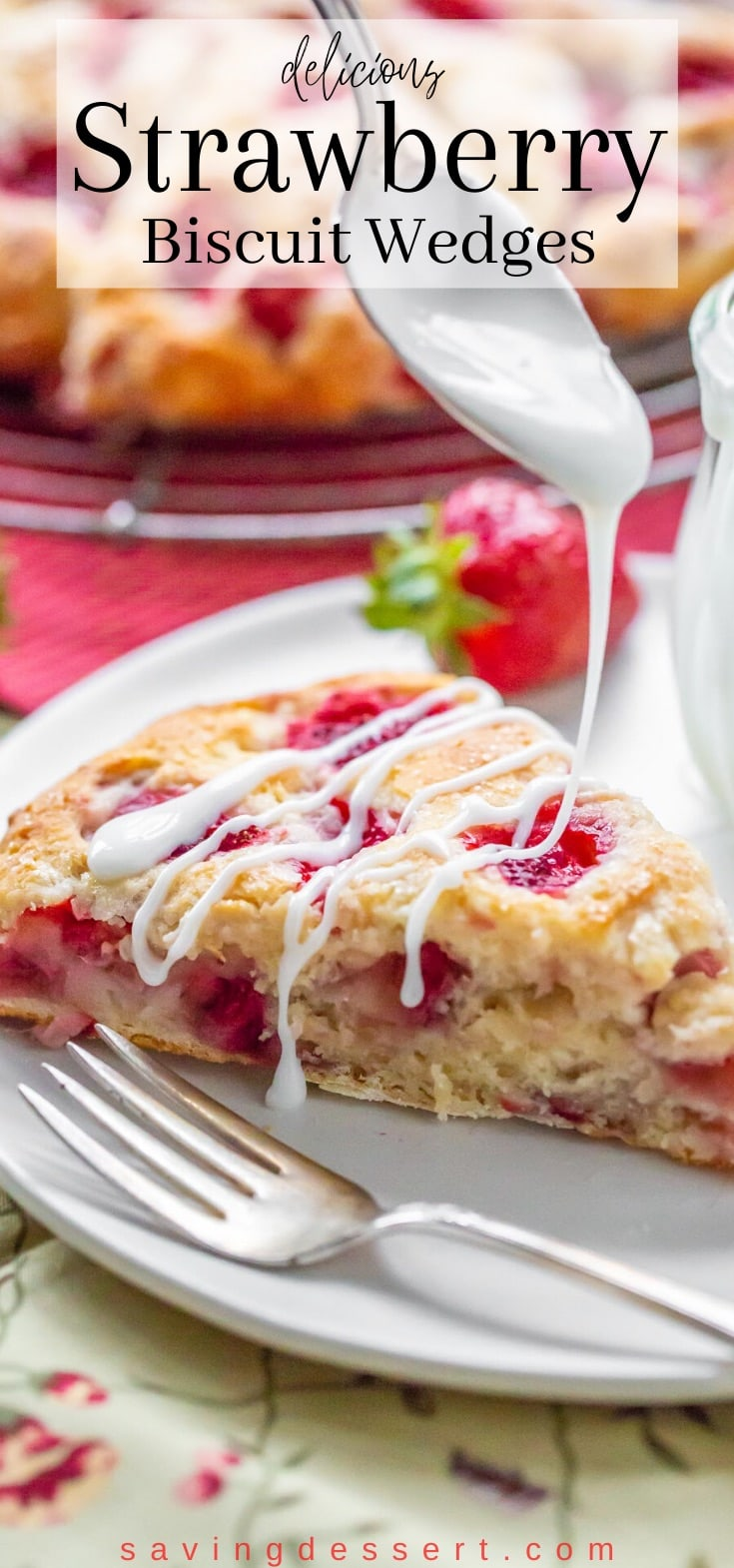 A biscuit wedge filled with chopped strawberries being drizzled with a simple icing
