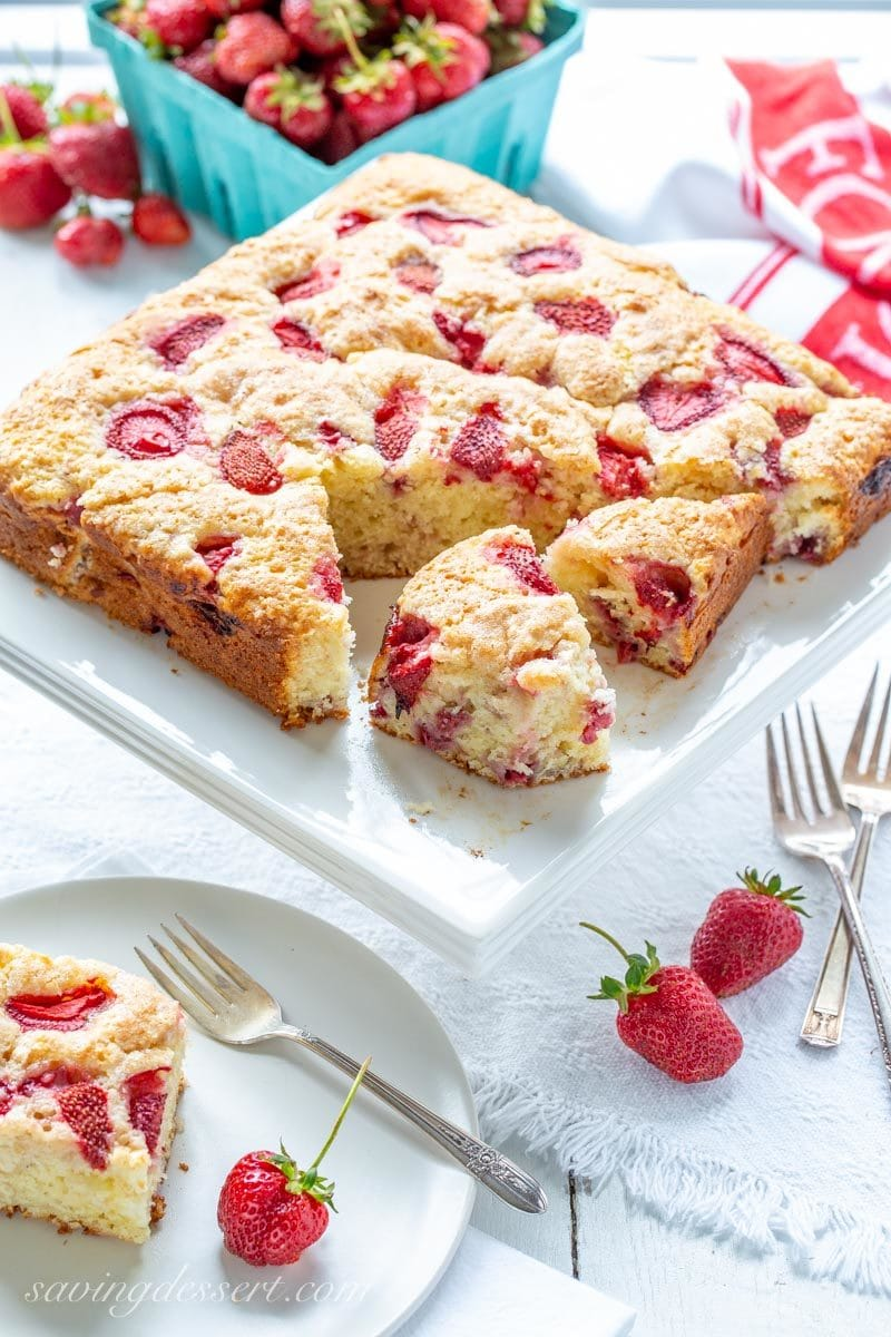 sliced strawberry breakfast cake with fresh strawberries