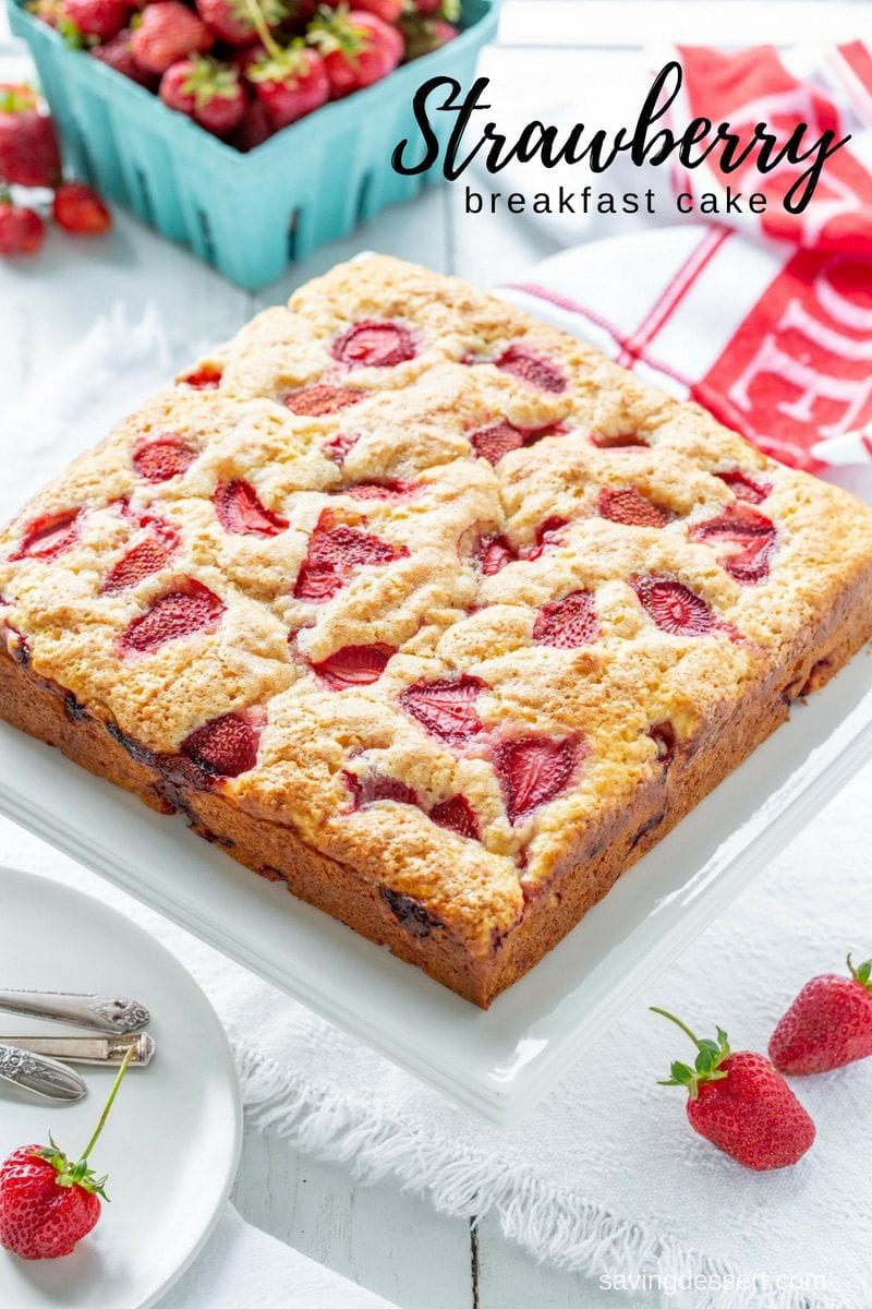 Strawberry Breakfast Cake made with fresh juicy strawberries tucked into a moist sour cream batter. Not overly sweet, this cake is terrific served for breakfast, brunch or as a light dessert. #savingroomfordessert #breakfast #brunch #cake #strawberrycake #strawberrydessert #coffeecake