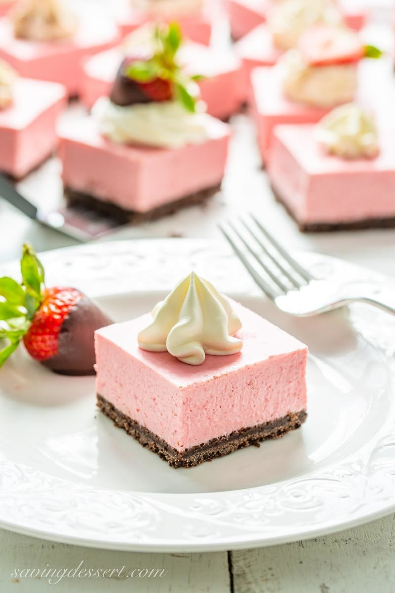 strawberry cheesecake bars with chocolate covered strawberries