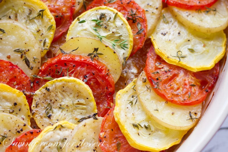 A casserole with tomatoes, potatoes, squash and onions layered