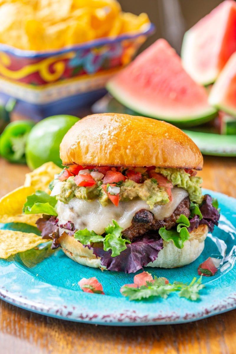 Cheesy Taco Burgers with Pico de Gallo and smashed avocado