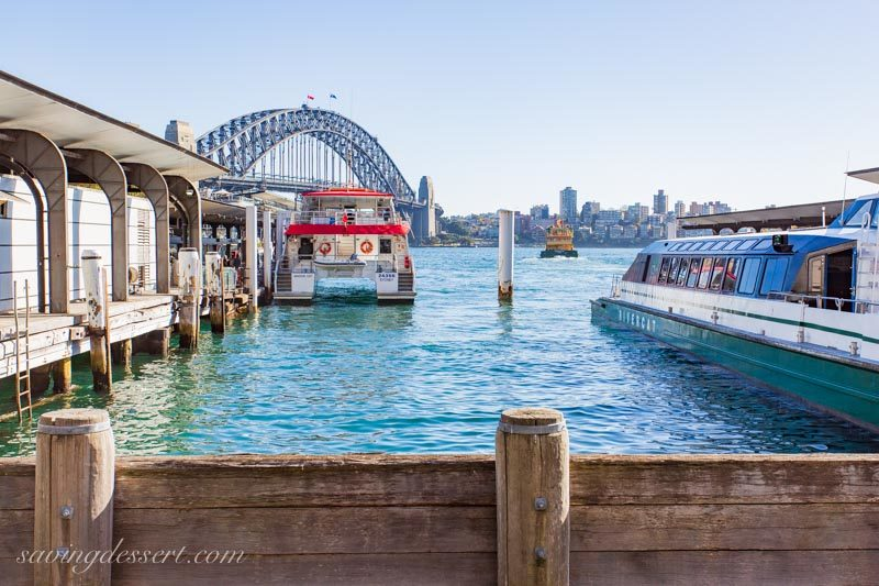 Circular Quay Wharf Sydney Australia with boats and a bridge in the background